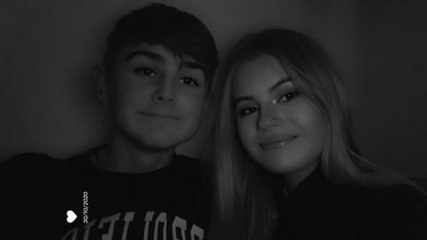 Connor and Lucy together in a black and white photo