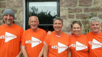 The five people who are rowing the Minch for MS, all wearing MS Society t-shirts