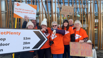 Six people wearing MS Society shirts campaign against the 20m benefits rule
