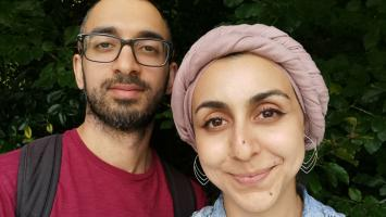 Noor and her husband stand together