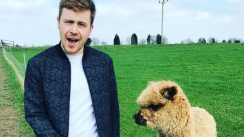 Photo of Robin Hatcher with an alpaca