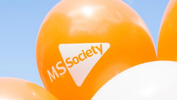 Photo: an orange MS balloon