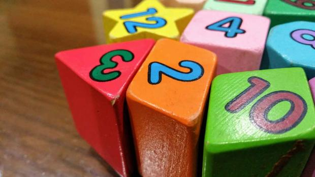 Photo: Some coloured children's toy blocks with numbers on them
