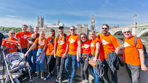 fundraisers stood next to the Thames and big ben