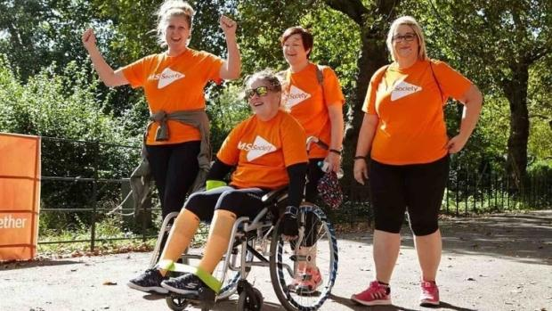 Photo: 4 women in MS T shirts on a fundraising walk