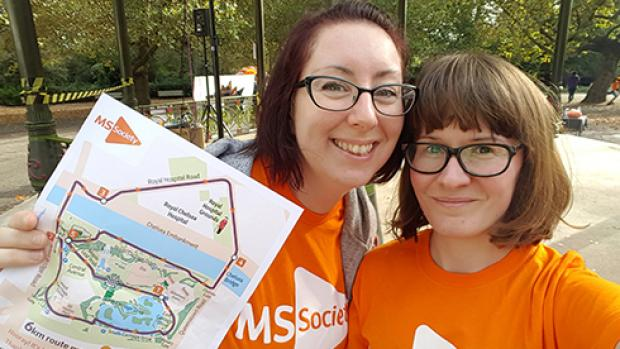 Two women on a MS walking event holding a map