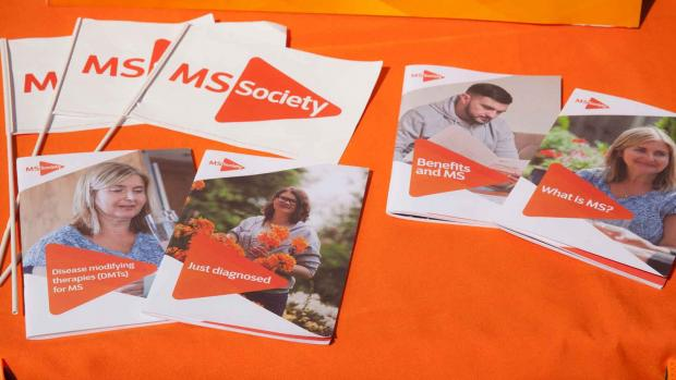 a photo of a display of MS information booklets