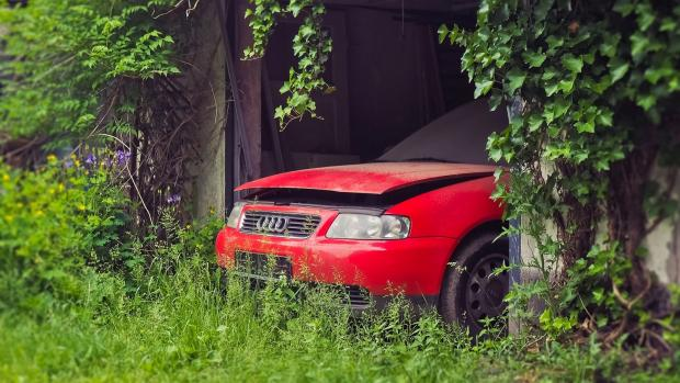 An old red car in a garage