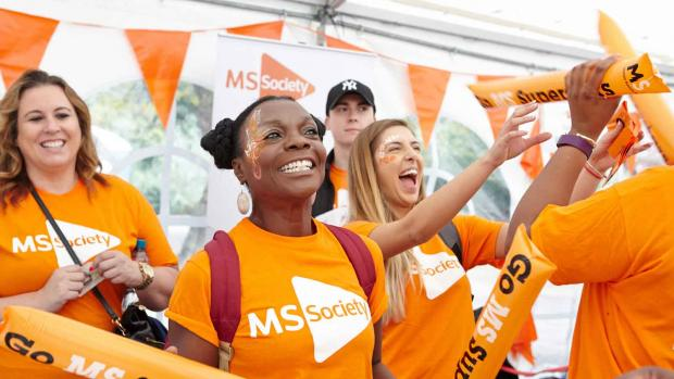 Photo: a group of MS fundraisers cheering with smiling faces