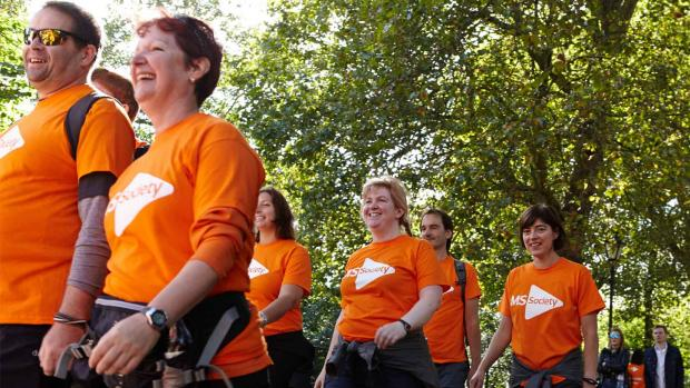 Photo: a group of MS fundraisers in a walking event with smiling faces