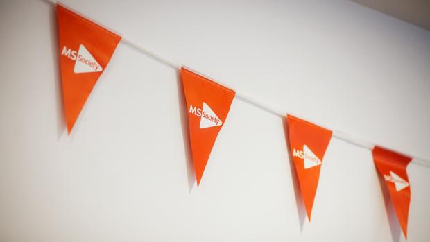 Some orange MS bunting on a wall
