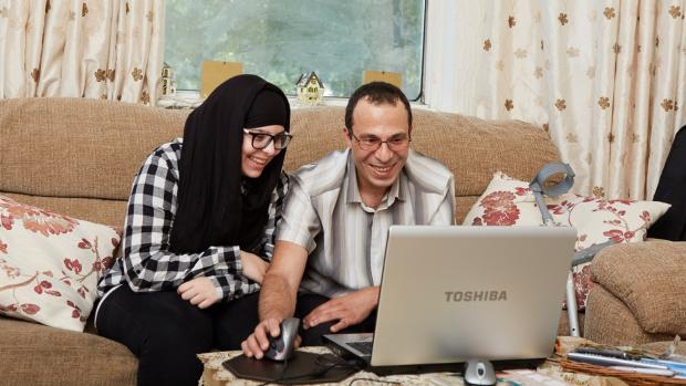 Couple at home on laptop