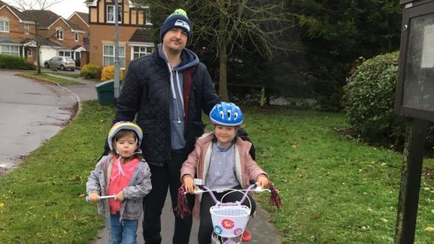 Dave and his two daughters on a walk.