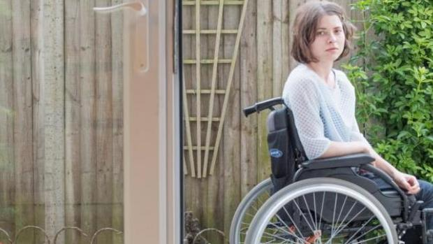 a photo of Edith outside in her wheelchair