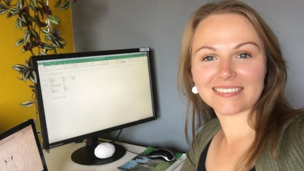 Image shows Dr Lindsey Forbes, a researcher, carrying out data analysis on her computer from home