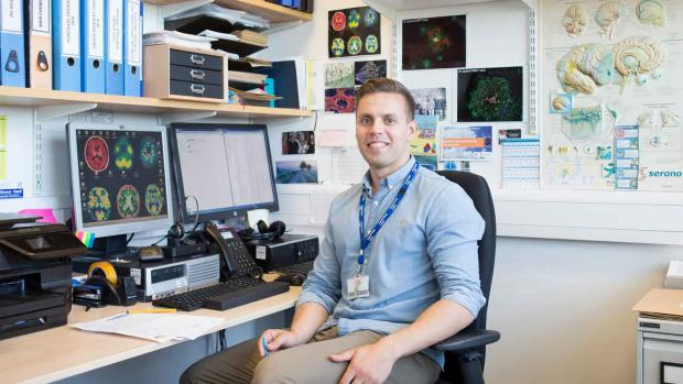Photo: Researcher in his office, smiling