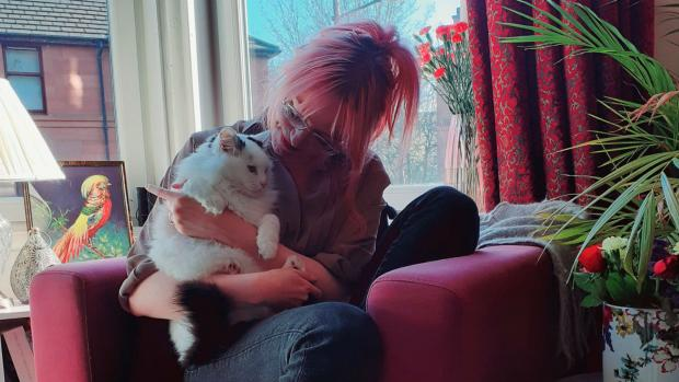 Rose and her cat Frankie in their flat