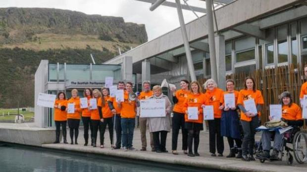 A group of MS campaigners outside the Scottish Parliament