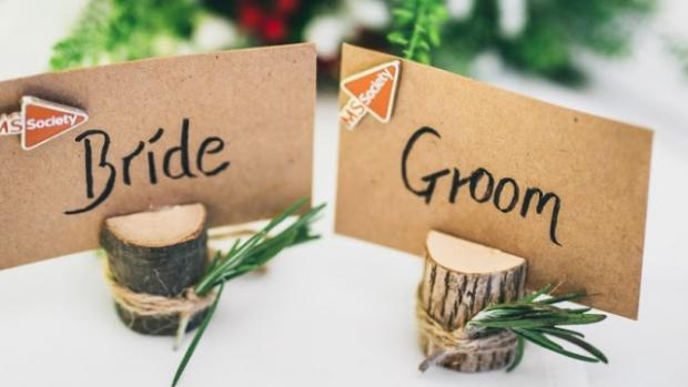 Bride and Groom place names on wedding table with MS Society logos