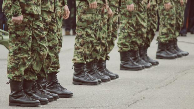 Photo: A close up of the feet of some soldiers standing in a row