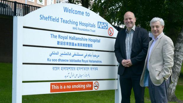 Photo: HSCT researchers Professor Basil Sharrack and Professor John Snowden standing outside Sheffield's Royal Hallamshire Hospital