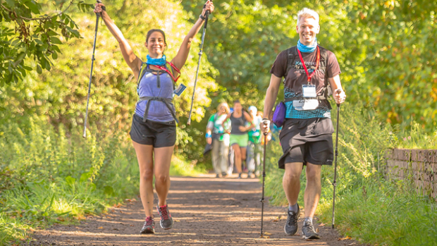 Two people walk the Thames Path Challenge