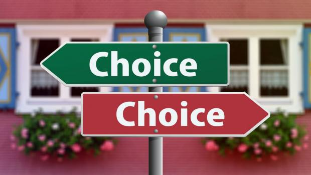 Photo: A sign post with signs saying 'choice' pointing in different directions.