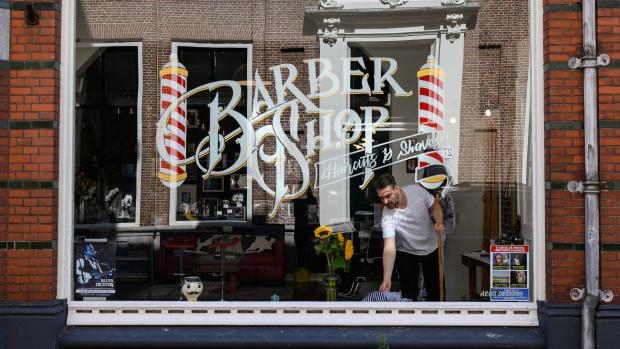 Image shows front of a Barber Shop.