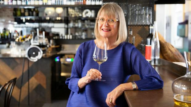 Jancis holding a glass of wine
