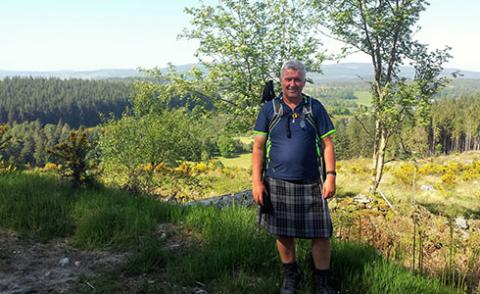 Image shows Colin in a kilt on a sunny day