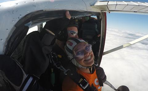 image shows Lindsay about to sky dive from a plane