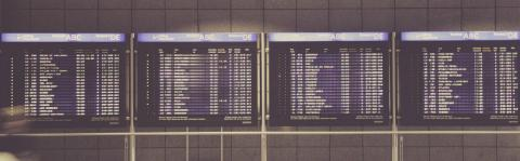 a photo of an airport departure board