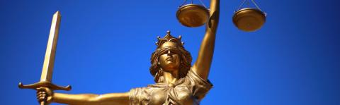 Statue holding sword and scales of justice