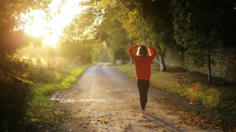 Woman jogging sunshine