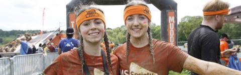 Two MS Society fundraisers at the finish line of Tough Mudder