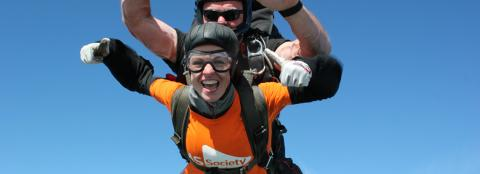 Man and woman sky diving